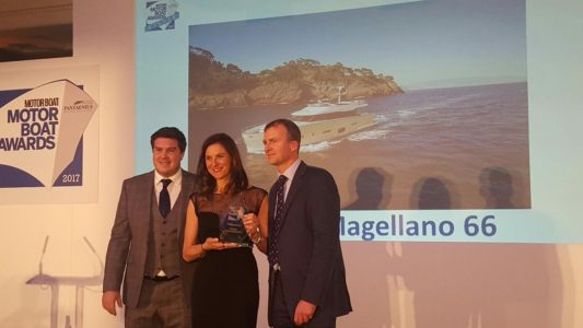 giovanna-vitelli-vice-president-ab-group-receives-the-mby-award-2017-on-the-left-jack-haines-deputy-editor-mby-on-the-right-hugo-andreae-editor-in-chief-mby